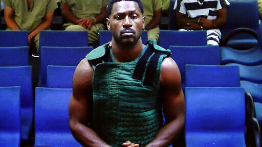NFL free agent Antonio Brown appears at the Broward County Courthouse in Fort Lauderdale, Fla., via video link  Friday, Jan. 24, 2020. Brown was granted bail on Friday after spending the night in a Florida jail. The wide receiver will have to pay a bond of $110,000, surrender his passport, wear a monitor, get mental health evaluation and pass random drug tests. He also can't have guns. Brown is accused of attacking the driver of a moving truck that carried some of his possessions from California.