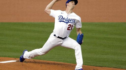 Los Angeles Dodgers starting pitcher Walker Buehler throws to the plate against the Colorado Rockies during the first inning on Friday in Los Angeles.