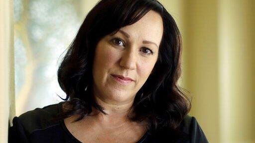 FILE - In this Aug. 9, 2018 file photo, MJ Hegar poses for a portrait at her home in Round Rock.