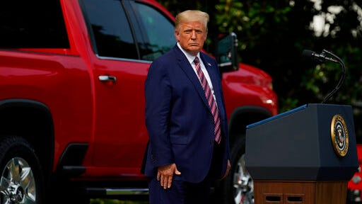 President Donald Trump pauses as he speaks during an event on regulatory reform on the South Lawn of the White House, Thursday, July 16, 2020, in Washington.