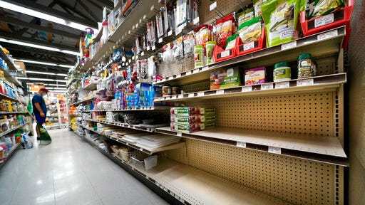 Shelves that are usually stocks with Mason jars and lids in the canning supply section are mostly empty at the Drillin True Value hardware store, Friday, Sept. 4, 2020, in South Portland, Maine. During this ongoing coronavirus pandemic many retailers have been frustrated by the scarce supply of jars and lids used for canning vegetables.
