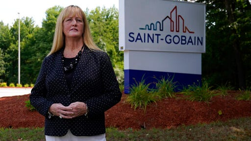 In this Friday, Aug. 14, 2020, photo New Hampshire Rep. Nancy Murphy, D-Merrimack, poses for a photo outside the Saint-Gobain plastics factory in Merrimack, N.H.