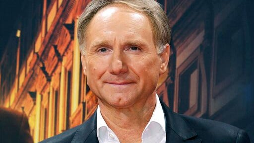 """FILE - In this Oct. 10, 2016 file photo, author Dan Brown arrives for the premiere of the movie """"Inferno"""" in Berlin. Blythe Brown, the author's ex-wife, filed a lawsuit Monday, June 29, 2020, in New Hampshire alleging he led a secret life during their marriage that included several affairs. The pair divorced in 2019 after 21 years of marriage."""