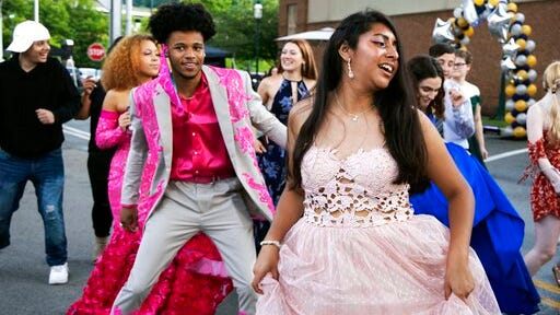FILE - In this June 23, 2020, file photo, Steel Valley High School students dance at their prom at the Waterfront Shopping Center in Homestead, Pa., organized by one of the student's father after the school's prom was canceled amid the coronavirus pandemic. Amid the debate over how to reopen schools safely, some teens and parents are organizing private proms to replace events canceled because of the coronavirus.