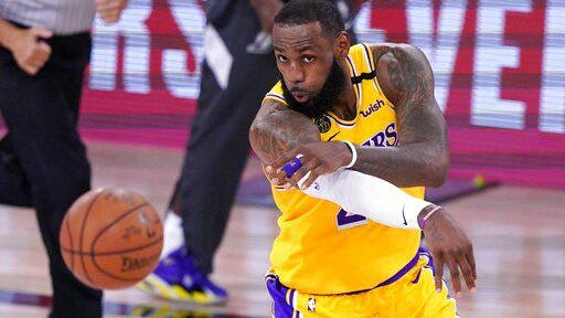 Los Angeles Lakers forward LeBron Jame makes a pass during the second half an NBA conference final playoff game against the Denver Nuggets on Friday in Lake Buena Vista, Fla.