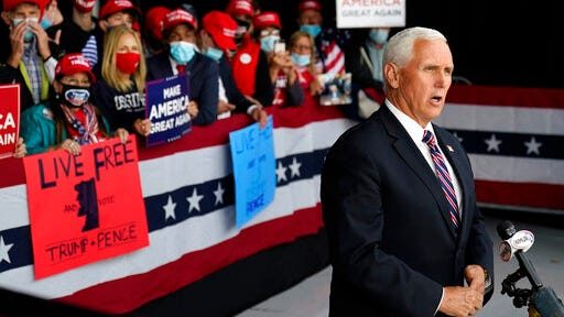 Vice President Mike Pence gives a television interview after a campaign rally, Tuesday, Sept. 22, 2020, at Lanconia Municipal Airport in Gilford, N.H.