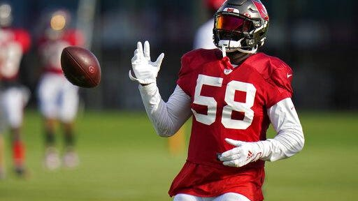 Tampa Bay Buccaneers linebacker Shaquil Barrett knocks the ball away during NFL football training camp in Tampa, Fla., in August. Barrett faces his old team when the Bucs face the Broncos today in Denver.