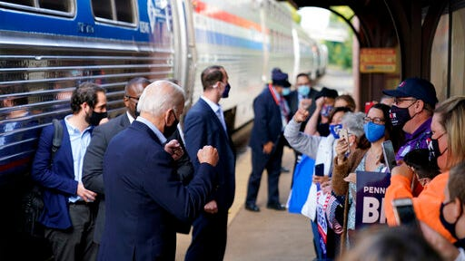 Democratic presidential candidate former Vice President Joe Biden greets supporters on the platform outside the Amtrak's Greensburg Train Station, Wednesday, Sept. 30, 2020, in Greensburg, Pa. Biden is on a train tour through Ohio and Pennsylvania today.