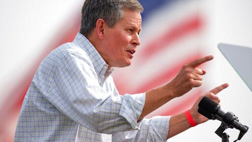 FILE - In this Sept. 14, 2020, file photo, Sen. Steve Daines, R- Mont., speaks to a crowd of supporters at a Republican campaign rally in Belgrade, Mont. Incumbent Republican Daines faces off Saturday, Oct. 10, 2020, in the last of three debates against his Democratic opponent, Montana Gov. Steve Bullock, in a race that is among the GOP-held seats in states won by President Trump in 2016 that Democrats think they have a chance to flip in November.