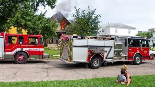 Flames engulf a house at 710 S.W. Polk on Tuesday afternoon.
