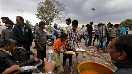 Nepalese people affected by the earthquake stand in line to receive food from a non-governmental organization in Kathmandu, Nepal, on Monday.