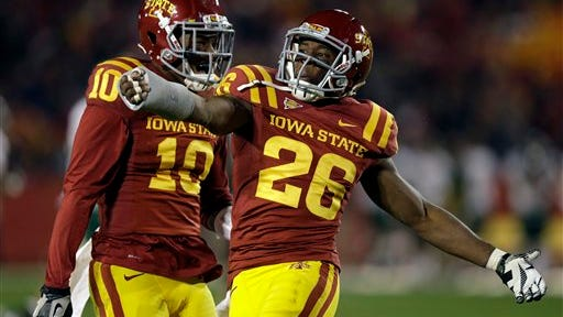 Iowa State defensive back Deon Broomfield, right, reacts with teammate Jacques Washington after intercepting a pass against Baylor during the second half of an NCAA college football game on Saturday, Oct. 27, 2012, in Ames, Iowa. (AP Photo/Charlie Neibergall)