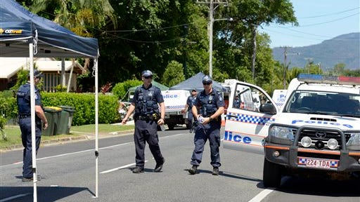 Police patrol near a house where eight children have been found dead in a Cairns suburb in far north Queensland, Australia, Friday Dec 19, 2014.