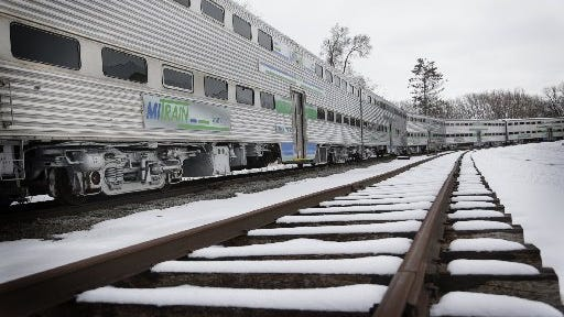 Railcars sit idle in Owosso at a cost of $3,000 a day to the state