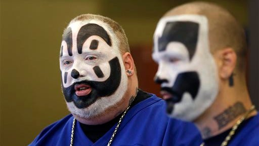 Joseph Bruce, aka Violent J, left, and Joseph Utsler, aka Shaggy 2 Dope, members of the Insane Clown Posse, address the media in Detroit. The U.S. Justice Department is asking a judge to dismiss a lawsuit by Insane Clown Posse, which objects to a report that describes its fans as a dangerous gang. A Detroit federal judge holds a hearing Monday, June 23, 2014. The government says the rap-metal duo from the Detroit area and its fans have no standing to sue.