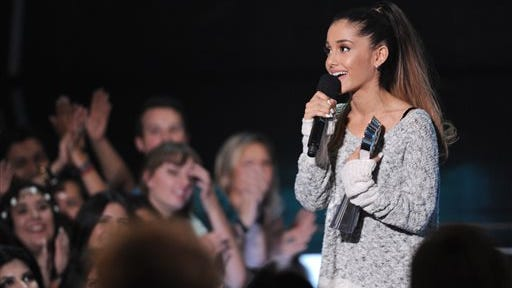Ariana Grande speaks at the iHeartRadio Music Awards at the Shrine Auditorium, in Los Angeles. Grande is having a breakthrough in music with the multiplatinum hit ?Problem,? which is spending its 13th week in the top 10 on the Billboard Hot 100 chart. The song features rapper Iggy Azalea and is from Grande?s sophomore album, ?My Everything,? released Monday.