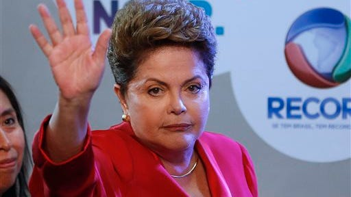 Brazil's President Dilma Rousseff, presidential candidate for re-election of the Workers Party (PT), gestures to journalists prior to a televised presidential debate in Sao Paulo, Brazil, Sunday, Sept. 28, 2014. Brazil will hold general elections on Oct. 5.