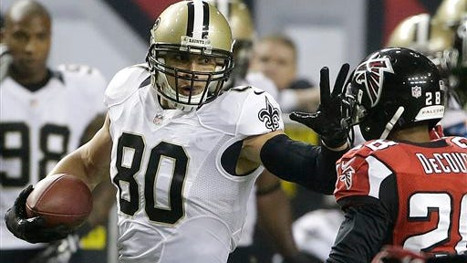 FILE - In this Nov. 21, 2013 file photo, New Orleans Saints tight end Jimmy Graham (80) tries to get past Atlanta Falcons free safety Thomas DeCoud (28) during the second half of an NFL football game in Atlanta.