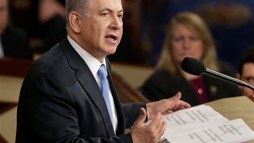 """Israeli Prime Minister Benjamin Netanyahu speaks before a joint meeting of Congress on Capitol Hill Tuesday. In a speech that stirred political intrigue in two countries, Netanyahu told Congress that negotiations underway between Iran and the U.S. would """"all but guarantee"""" that Tehran will get nuclear weapons, a step that the world must avoid at all costs."""