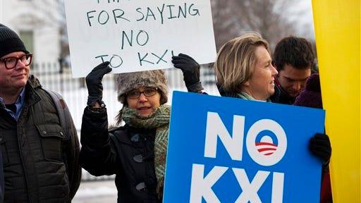 Yvette Torell, left, with 350.org, and Melinda Pierce of the Sierra Club celebrate President Barack Obama's veto of pro-Keystone XL legislation outside the White House on Feb. 24, 2015.