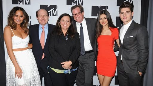 """FILE - This April 24, 2014 file photo shows, from left, Chrissy Teigen of MTV's """"Snack Off"""", CEO of Viacom Philippe Dauman, President of Programming for MTV Susanne Daniels, COO of Viacom Tom Dooley, Victoria Justice of MTV's """"Eye Candy"""" and Gregg Sulkin of MTV's """"Faking It"""" during the 2014 MTV Upfront Presentation in New York."""