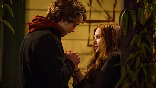 "This image released by Warner Bros. Pictures shows Jamie Blackley, left, and Chloe Grace Moretz in a scene from ""If I Stay."""