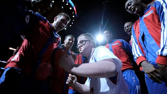 Kevin Grow participates in the Philadelphia 76ers' pre-game huddle before a game against the Cleveland Cavaliers on Tuesday in Philadelphia. (AP Photo/Michael Perez)