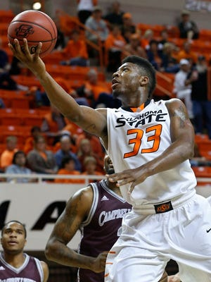 Oklahoma State guard Marcus Smart returns as a preseason All-American after bypassing the NBA.