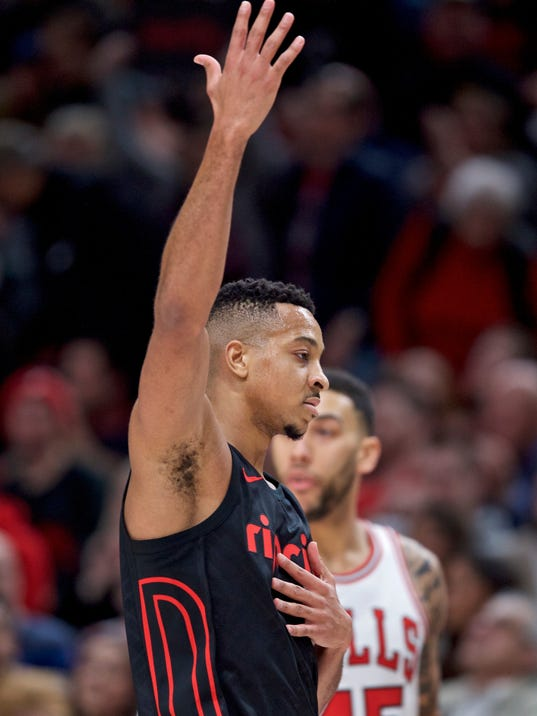 Portland Trail Blazers guard CJ McCollum reacts after making a three-point basket against the Chicago Bulls during the first half of an NBA basketball game in Portland, Ore., Wednesday, Jan. 31, 2018. (AP Photo/Craig Mitchelldyer)