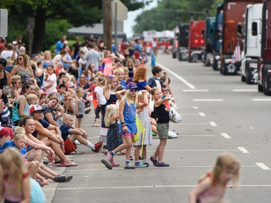 Children wait for candy to be thrown from floats Wednesday during the St. Joseph Lions 2018 Fourth of July Parade.
