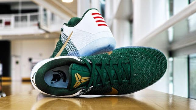 The special edition Michigan State-themed Kobe 11s. It is unknown if and when the Spartans will wear the shoes. Duke, Kentucky and Oregon were also given customized Kobe 11s.
