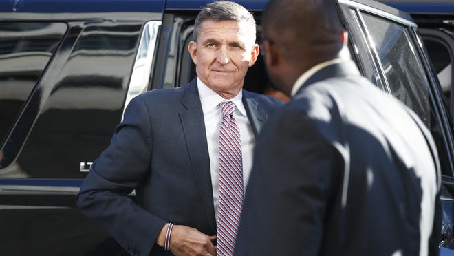 FILE - In this Dec. 18, 2018, file photo, President Donald Trump's former national security adviser Michael Flynn arrives at federal court in Washington. Flynn told the special counsel's office that people connected to the Trump administration and Congress contacted him about his cooperation with the Russia investigation. That's according to a court filing from prosecutors Thursday, May 16, 2019, that describes the extent of Flynn's cooperation with the probe. (AP Photo/Carolyn Kaster, File)