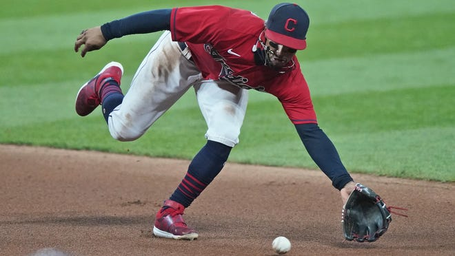 Cleveland Indians' Francisco Lindor fields a single hit by Kansas City Royals' Alex Gordon in the seventh inning of a baseball game, Tuesday, Sept. 8, 2020, in Cleveland.