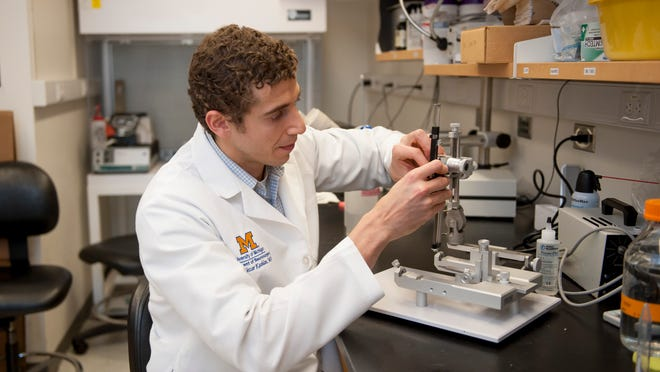 To study Alzheimer's, UM neurosurgeon Osama Kashlan sets up a system to perform surgery on mice to inject stem cells.