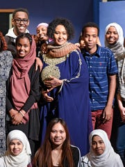 Somali singer Nimco Yasin poses for photographs with students following a performance Thursday, April 13, at Apollo High School.