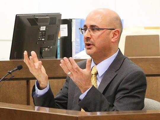 Medical Examiner Dr. Andrew Falzon.