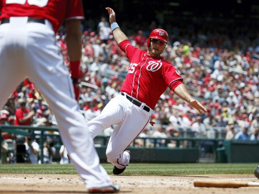 Washington's Clint Robinson (25) scores during the first inning of Sunday's game against the Pittsburgh Pirates at Nationals Park in Washington. The Nationals scored a team-record nine times in the first inning for all the offense they would need in a 9-2 victory.
