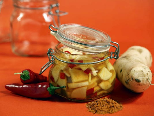 Cookbook author Marlena Spieler likes to have a pickle on the table for the holiday. This pickled daikon with hot peppers has a sweet flavor, in keeping with Rosh Hashana traditions. (E. Jason Wambsgans/Chicago Tribune/TNS)