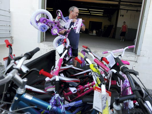 Ken Welsh, with the York County Toys for Tots, unloads bikes into a new storage area located in West Manchester Township on Saturday, July 25, 2015. The organization needed to move their toys to a new location  when the space they were using in Springettsbury Township was sold.  Jason Plotkin - Daily Record/Sunday News