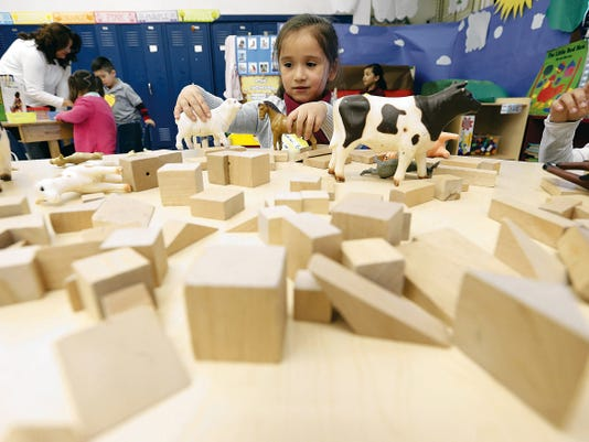 Clardy Elementary School pre-K student Sarai Gonzalez plays in her classroom Tuesday. EPISD, along with SISD, is considering opening up its pre-K program to students who didn't previously qualify for a fee.