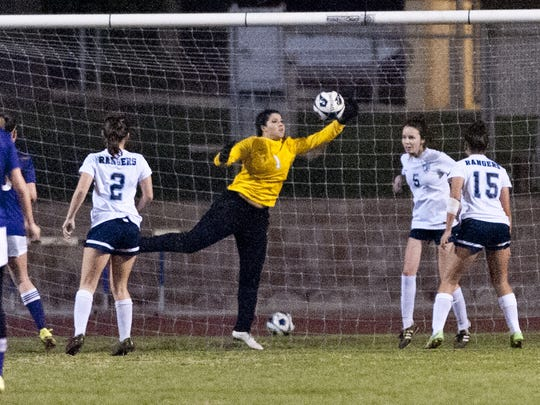 Redwood goalie Aubrey Mills makes a save against Lemoore in a Central Section Division II girls soccer semifinal on Tuesday, February 23, 2016.