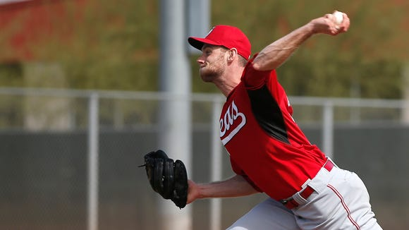 Reds pitcher Tony Cingrani throws during live batting