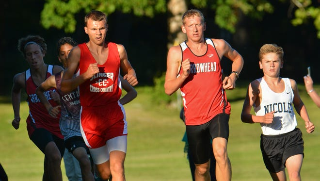 Arrowhead's Cole Sandvold (center) has been named to the 2016 Journal Sentinel all-area cross country team.