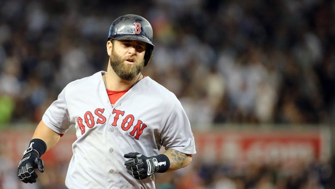 Mike Napoli rounds the bases after hitting a home run in the ninth inning.