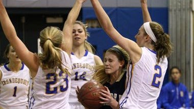 Sutherland's Liz Greendyke (13) drives to the basket through a trio of Irondequoit defenders Jourdan Roemer (23), Savannah Crocetti (14) and Kylee Kanealey (2).