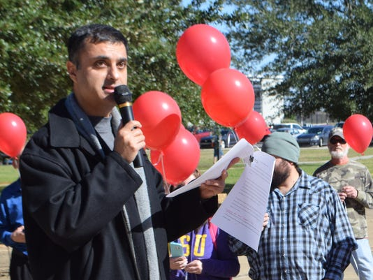 "Shonu Nangia, associate professor of foreign languages at LSU of Alexandria, talks to LSUA students and faculty Tuesday prior to the ""LSUA Release for Peace."" The LSUA Student Government held a balloon release to honor those around the world affected by terror and natural disasters."