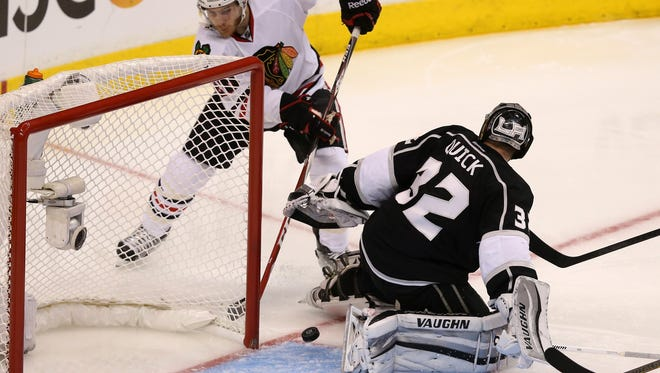 Ben Smith of the Blackhawks scores off the skate of goaltender Jonathan Quick of the Kings in the second period of Game 6 of the Western Conference final Friday night in Los Angeles.