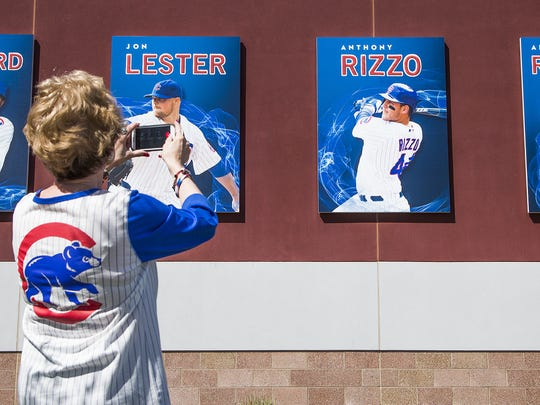 Patty Day, from Madison, Wisc., takes photos outside Sloan Park in Mesa before a spring-training game in March.