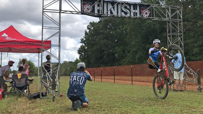 Cayden Parker of Hot Springs crosses the finish line Sunday, July 26, 2020, at the River Valley Rumble mountain bike race in Ben Geren Regional Park as part of the Arkansas Mountain Bike Championship Series. The event attracted 153 riders from the Southern and Midwest regions to compete in both professional and non-professional categories. Parker, 16, took first place in the Category 1 15-29 age division. He rides for the Bear National Team.