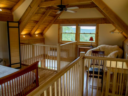The upstairs bedroom of a modular tiny house built